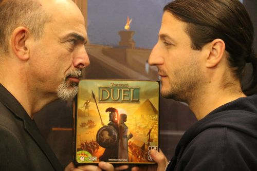 Bruno Cathala v.s Antoine Bauza ... know you opponent @ Spiel in Essen 2015 One of my favorite. I asked them to pose at the booth and they really liked the result. Working close as a team of designers to create the game where knowing you opponent brings out tenseness during the Duel.