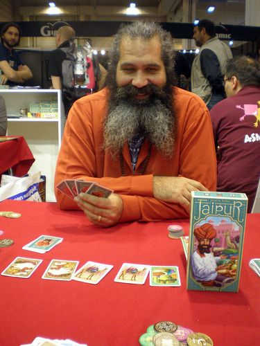 "Playing Against the Man on the Cover @ Spiel 2009 I was playing the game explained by the man in front of me and later I saw the box cover and was saying: ""I played against the man of the cover Malcolm Braff"". A nice moment at Spiel in Essen"