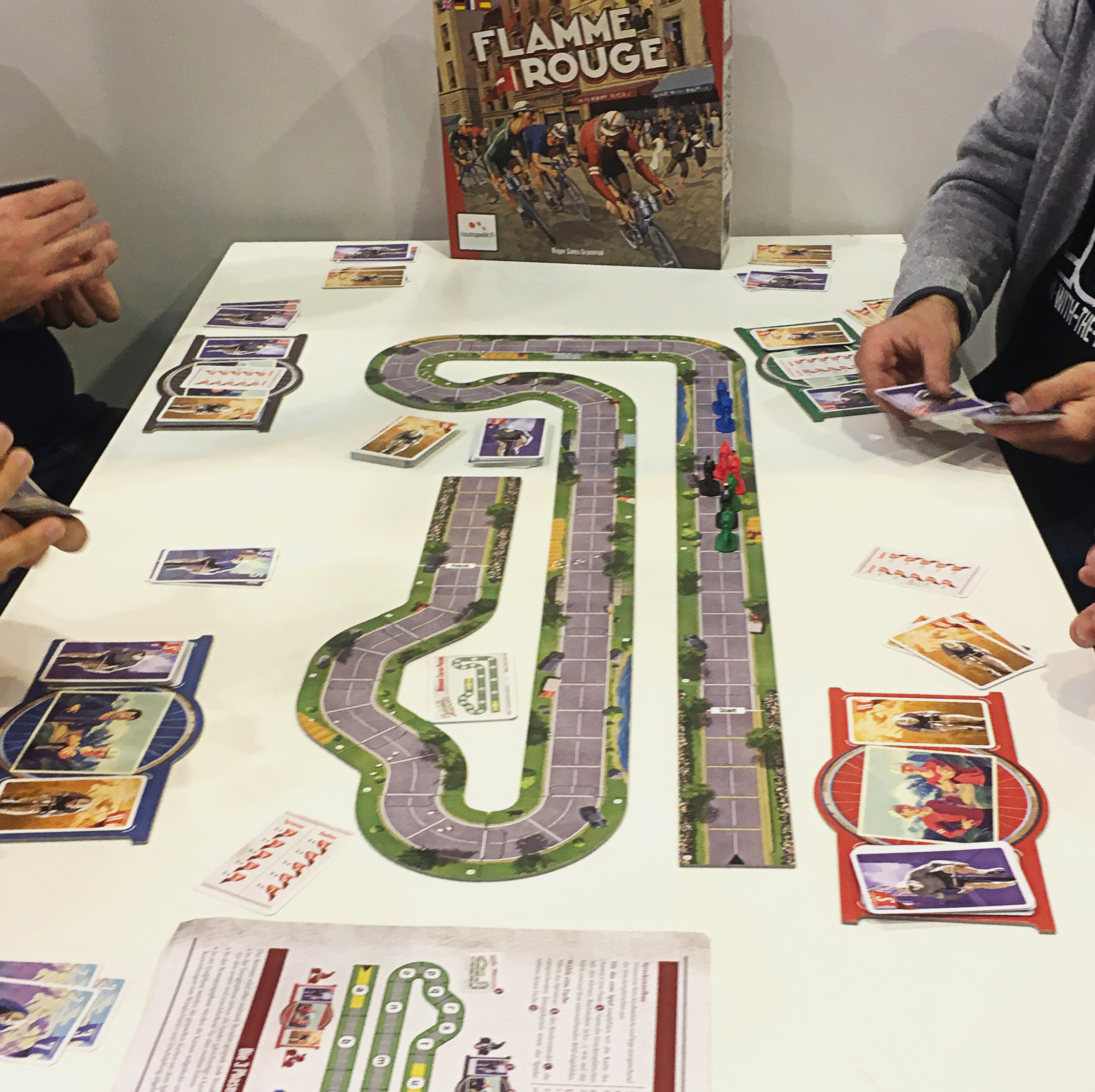People playing La Flamme Rouge at Essen.